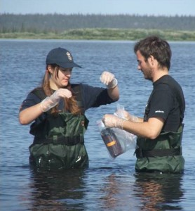 coop students taking water sample